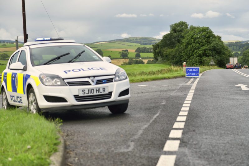 road surfacing squeegee police car